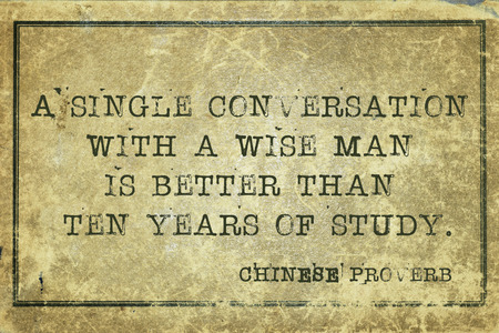 proverb: A single conversation with a wise man is better - ancient Chinese proverb printed on grunge vintage cardboard Stock Photo