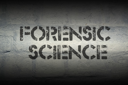 forensic: forensic science stencil print on the grunge white brick wall
