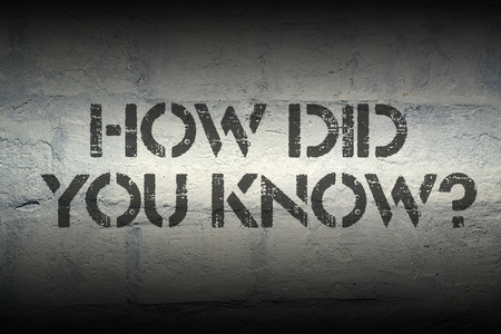 know: how did you know question stencil print on the grunge white brick wall Stock Photo