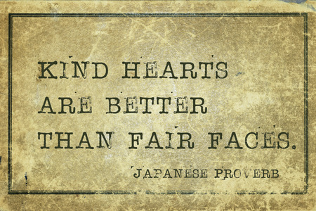 ancient japanese: Kind hearts are better than fair faces - ancient Japanese proverb printed on grunge vintage cardboard Stock Photo