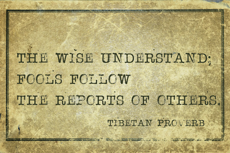 understand: The wise understand; fools follow the reports  - ancient Tibetan proverb printed on grunge vintage cardboard