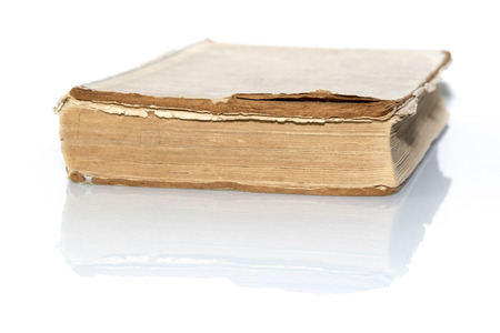 reflective: old book isolated on white reflective surface