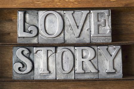 phrase novel: love story phrase made from metallic letterpress type on wooden tray