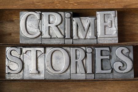 phrase novel: crime stories phrase made from metallic letterpress type on wooden tray Stock Photo