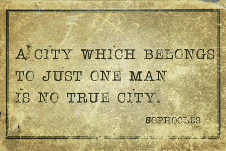 belongs: A city which belongs to just one man is no true city - ancient Greek philosopher Sophocles quote printed on grunge vintage cardboard Stock Photo