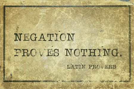 proverb: Negation proves nothing - ancient Latin proverb printed on grunge vintage cardboard