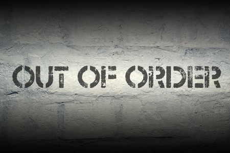 out of order: out of order stencil print on the grunge white brick wall Stock Photo