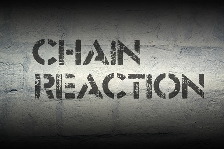 chain reaction: chain reaction stencil print on the grunge white brick wall Stock Photo