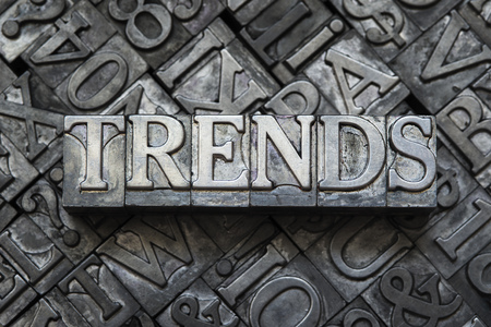 news values: trends concept made from metallic letterpress type on letter blocks background