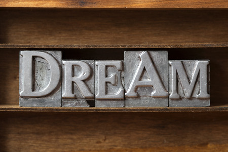 daydream: dream word made from metallic letterpress type on wooden tray Stock Photo