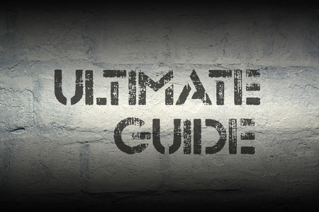 ultimate: ultimate guide stencil print on the grunge white brick wall