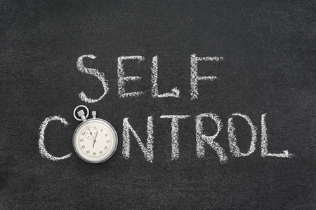 self control: self control phrase handwritten on chalkboard with vintage precise stopwatch used instead of O Stock Photo