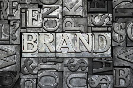 letter blocks: brand concept made from metallic letterpress type with letter blocks background