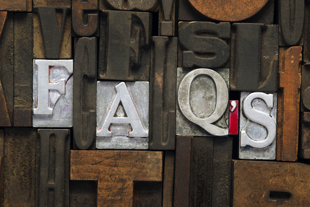 FAQs abbreviation made from metallic letterpress blocks in mixed wooden letters