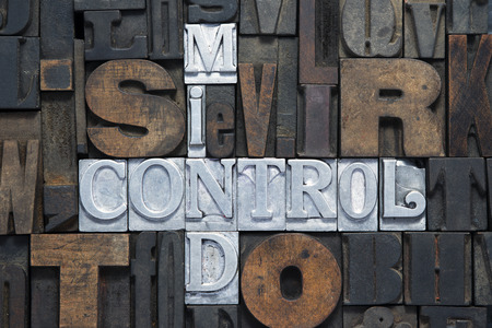 letterpress words: mind control cross words made from metallic letterpress blocks in mixed wooden letters