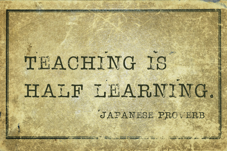 ancient japanese: Teaching is half learning - ancient Japanese proverb printed on grunge vintage cardboard