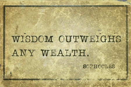 outweighs: Wisdom outweighs any wealth - ancient Greek philosopher Sophocles quote printed on grunge vintage cardboard