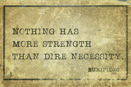 dire: Nothing has more strength than dire necessity - ancient Greek philosopher Euripides quote printed on grunge vintage cardboard Stock Photo