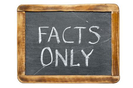 only: facts only phrase handwritten on vintage school slate board