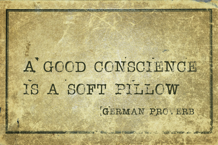 conscience: A good conscience is a soft pillow - ancient German proverb printed on grunge vintage cardboard Stock Photo