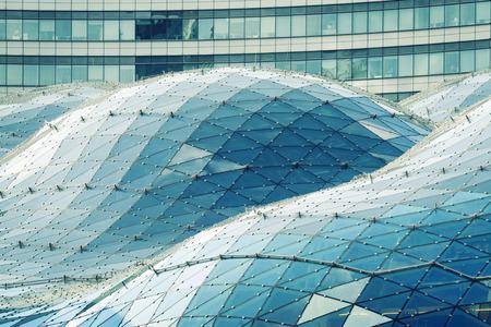 futuristic city: modern futuristic glass roof in center of Warsaw city, Poland