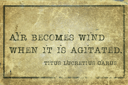 agitated: Air becomes wind when it is agitated - ancient Roman philosopher Lucretius quote printed on grunge vintage cardboard Stock Photo