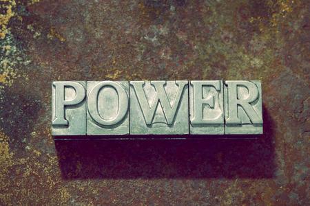 letterpress: power word made from metallic letterpress on rusty metallic background