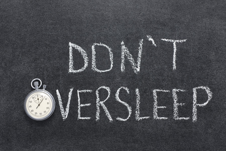 don't oversleep phrase handwritten on chalkboard with vintage precise stopwatch used instead of O Imagens
