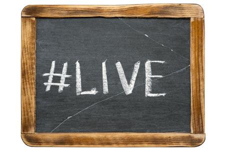 vital signs: live hashtag handwritten on vintage school slate board isolated on white Foto de archivo
