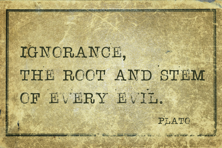 plato: Ignorance, the root and stem of every evil - ancient Greek philosopher Plato quote printed on grunge vintage cardboard Stock Photo