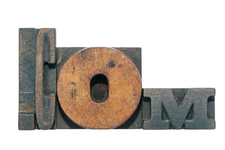 dot com: dot com made from wooden letterpress type isolated on white