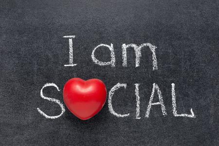 uniting: I am social phrase handwritten on blackboard with heart symbol instead of O