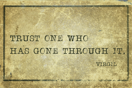 virgil: Trust one who has gone through it  - ancient Roman poet Virgil quote printed on grunge vintage cardboard Stock Photo