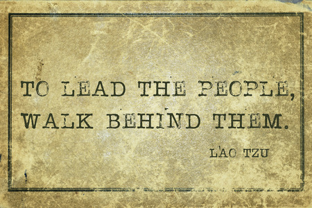 them: To lead the people, walk behind them - ancient Chinese philosopher Lao Tzu quote printed on grunge vintage cardboard Stock Photo