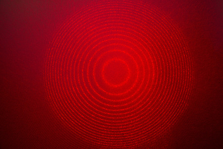 etalon: interference pattern of real He-Ne gas laser beam passed through etalon Fabry-Perot, image has typical speckle structure as feature of laser radiation