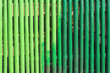 kind: wooden fence fragment painted by different kind of green paint