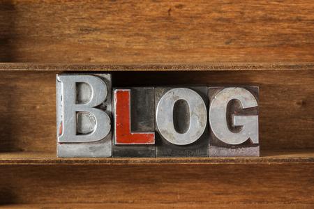 letterpress type: blog word made from metallic letterpress type on wooden tray