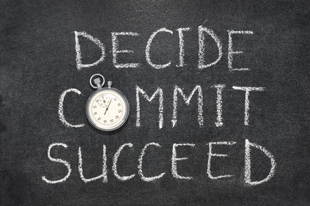 decide: decide, commit, succeed words handwritten on chalkboard with vintage precise stopwatch used instead of O Stock Photo