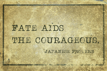Fate aids the courageous - ancient Japanese proverb printed on grunge vintage cardboard Stock Photo