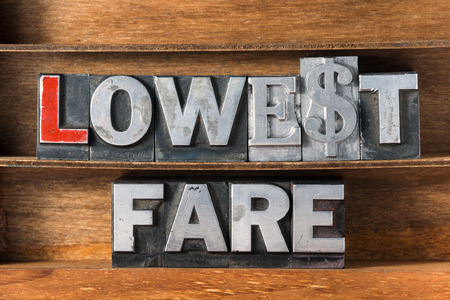 fare: lowest fare phrase made from metallic letterpress type on wooden tray Stock Photo