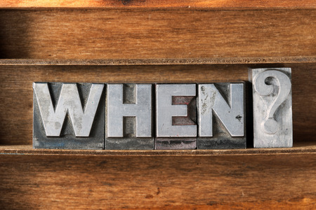 when: when question phrase made from metallic letterpress type on wooden tray Stock Photo