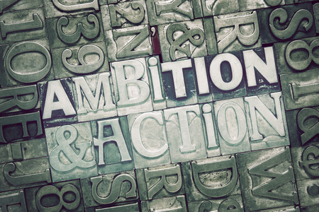 letterpress words: ambition and action words concept made from metallic letterpress blocks on letters background Stock Photo