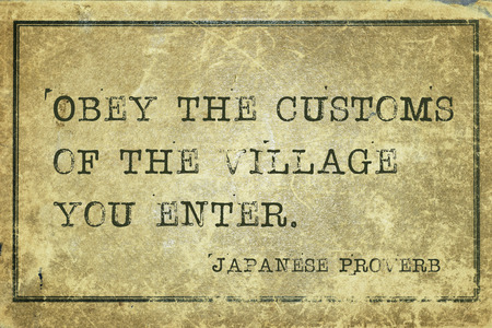 ancient japanese: Obey the customs of the village you enter - ancient Japanese proverb printed on grunge vintage cardboard