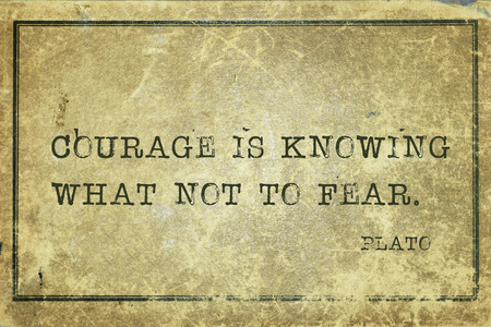plato: Courage is knowing what not to fear- ancient Greek philosopher Plato quote printed on grunge vintage cardboard
