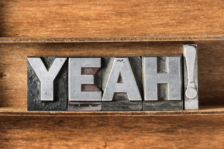 letterpress type: yeah exclamation made from metallic letterpress type on wooden tray