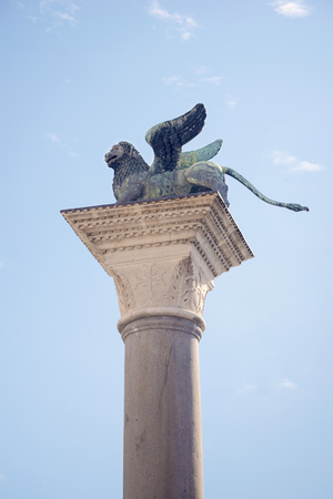 ancient lion: ancient Lion of St. Mark column set on Piazzetta square in Venice, Italy Stock Photo