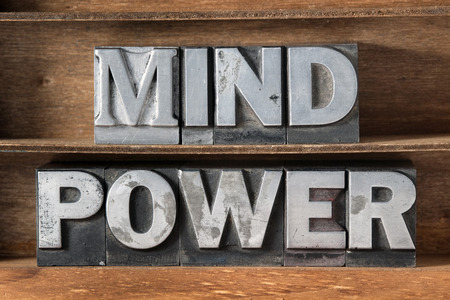 mind power phrase made from metallic letterpress type on wooden tray
