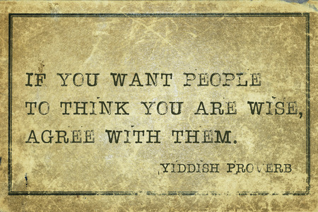 yiddish: If you want people to think you are wise - ancient Yiddish proverb printed on grunge vintage cardboard