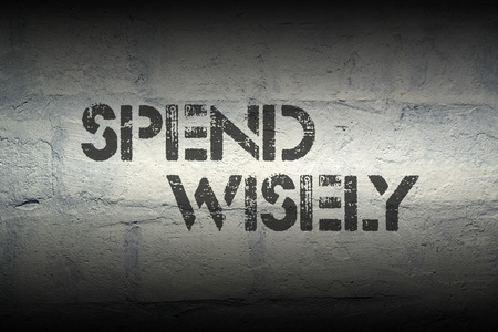 shopaholism: spend wisely stencil print on the grunge white brick wall