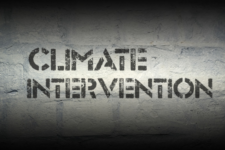 intervention: climate intervention stencil print on the grunge white brick wall